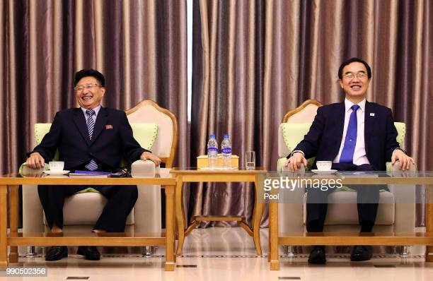South Korean Unification Minister Cho Myounggyon talks with North Korean Vice Sports Minister Won Kilu during their meeting at Pyongyang Sunan...