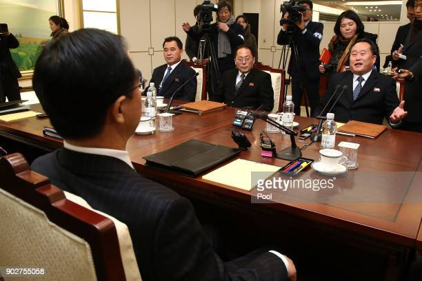 South Korean Unification Minister Cho Myounggyon talks with the head of North Korean delegation Ri SonGwon before their meeting at the Panmunjom in...