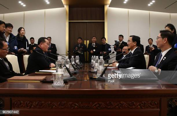 South Korean Unification Minister Cho MyoungGyon talks with the head of the North Korean delegation Ri SonGwon during their meeting at Panmunjom in...