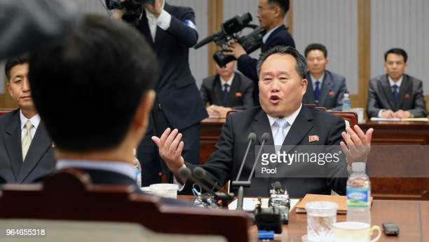 South Korean Unification Minister Cho Myounggyon talks with the head of North Korean delegation Ri SonGwon during their meeting on June 1 2018 in...
