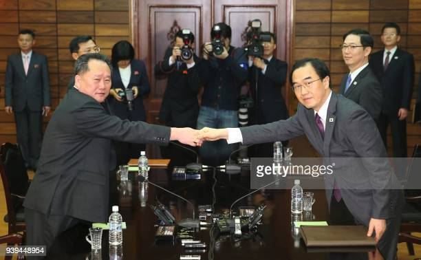 TOPSHOT South Korean Unification Minister Cho Myounggyun shakes hands with his North Korean counterpart Ri Son Gwon who is chairman of the North's...