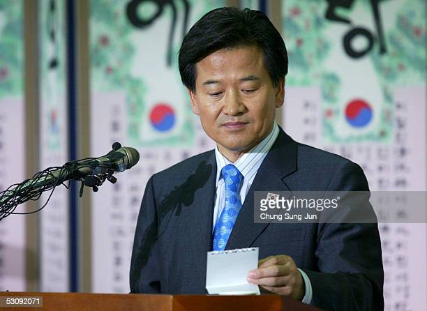 South Korean Unification Minister Chung DongYoung checks a memo during a press conference at the InterKorean Dialogue office on June 17 2005 in Seoul...