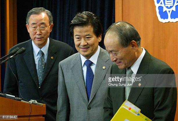 South Korean Unification Minister Chung DongYoung leave after a press conference to reconfirm South Korea's policy of not developing or possessing...