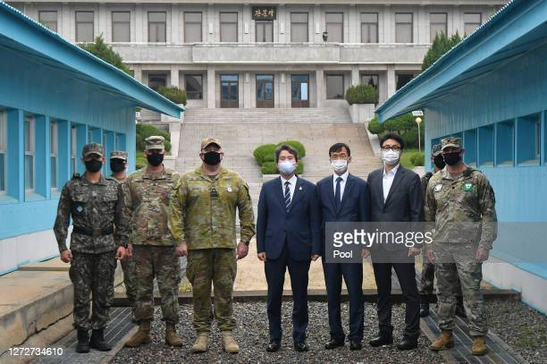 South Korean Unification Minister Lee Inyoung and officials pose with US and South Korean army soldiers at the military demarcation line during a...