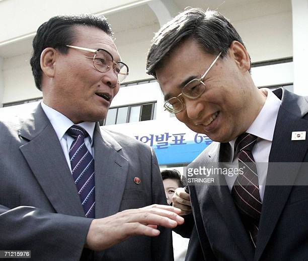 South Korean Unification Minister Lee Jongseok and Kim Young Dae chief of the North Korean government delegation talk as they arrive for the closing...