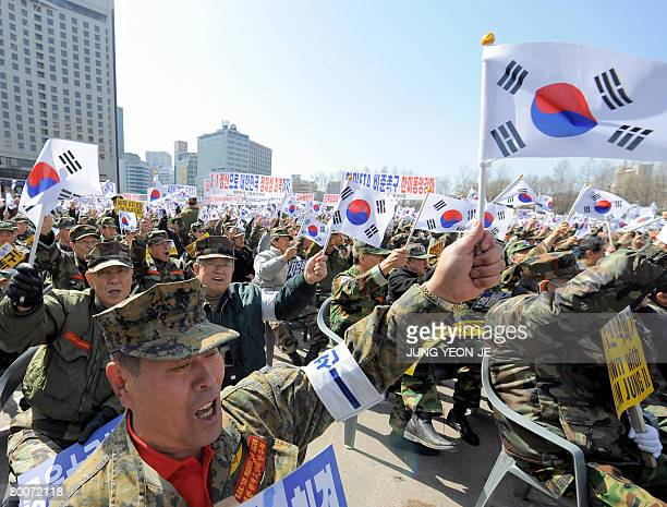 South Korean veterans wave the national flags to celebrate the March First Independence Movement Anniversary in downtown Seoul on March 1, 2008....