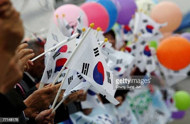 South Korean wave national flags during a South Korean President Roh MooHyun's departs for Pyongyang near the demilitarized zone separating the two...