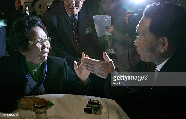 South Korean wife Sun SoonAe greets her North Korean husband Chun MoonSuk during the first round of thirteen separated Family's Reunion Meetings at...