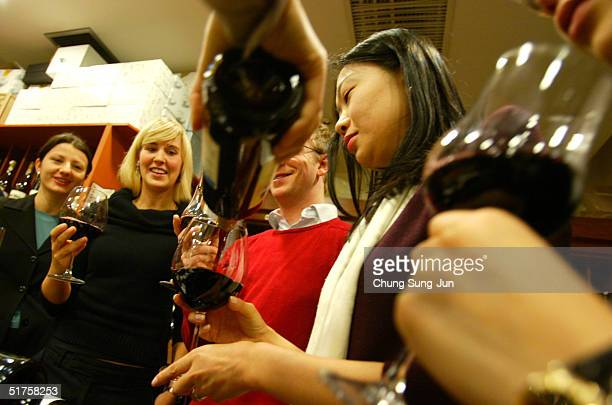 South Korean wine patrons taste the 2004 vintage Beaujolais Nouveau at a store November 18 2004 in Seoul South Korea The wine is traditionally...