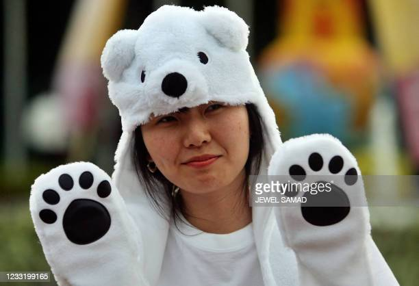 South Korean woman demonstrates at the venue of the UN Climate Change Conference 2007 in Nusa Dua, on Bali island, 11 December 2007. The worldwide...