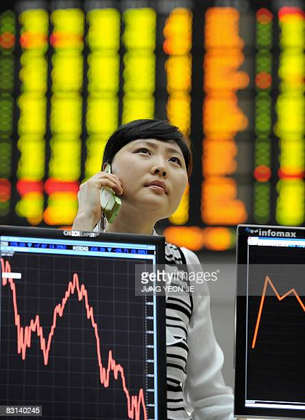A South Korean woman looks at a stock index board at the Korea Exchange in Seoul on October 6 2008 South Korean shares closed 43 percent lower...