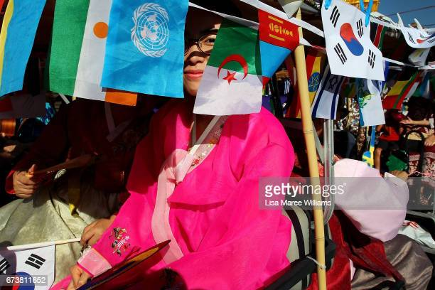 South Korean woman prepares to make her way along Peel Street during the annual Tamworth Country Music Festival Cavalcade on January 28 2017 in...