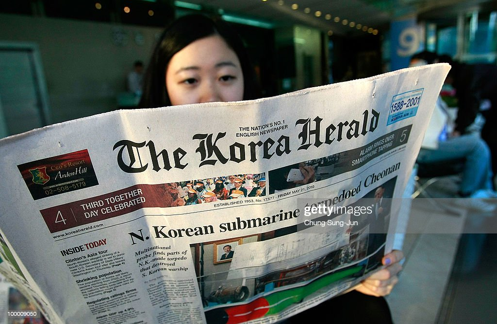 A South Korean woman reads a newspaper on May 20, 2010 in Seoul, South Korea. The multinational investigation team concluded that North Korea's torpedo sank the South Korean warship on March 26, killing 46 sailors.