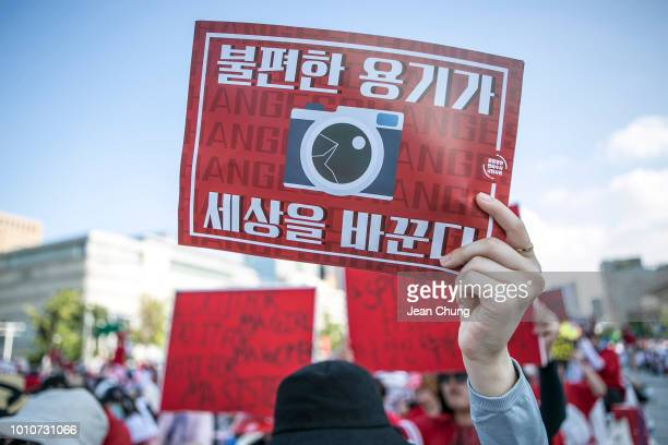 South Korean women protest against sexism and hidden camera pornography on August 4 2018 in Seoul South Korea Over 40000 women staged a protest to...