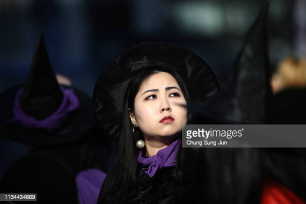 South Korean women wear witch costume participate in a rally supporting feminism to mark International World Women's Day on March 8, 2019 in Seoul,...