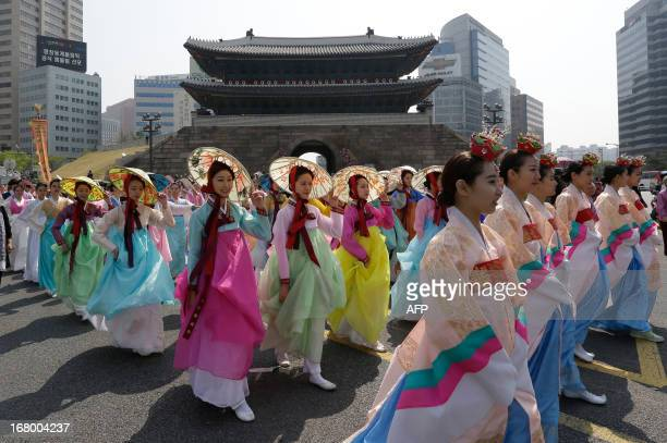 South Korean women wearing traditional dresses march on the street after the reopening ceremony of Namdaemun gate in Seoul on May 4 2013 South Korea...