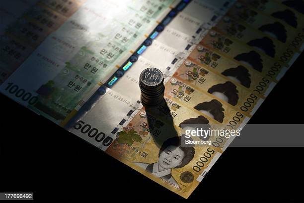 South Korean won banknotes and coins of various denominations are arranged for a photograph in Seoul South Korea on Saturday Aug 24 2013 South Koreas...