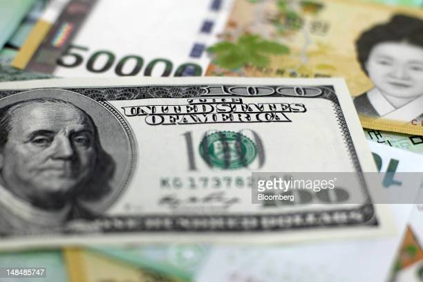 South Korean won banknotes and US onehundred dollar banknotes are arranged for a photograph in Seoul South Korea on Tuesday July 17 2012 South...
