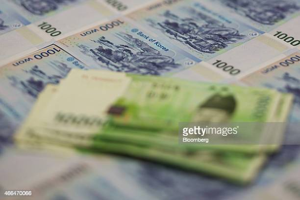 South Korean won banknotes are arranged for a photograph in Seoul South Korea on Monday March 16 2015 South Korea's won fell for a sixth day the...