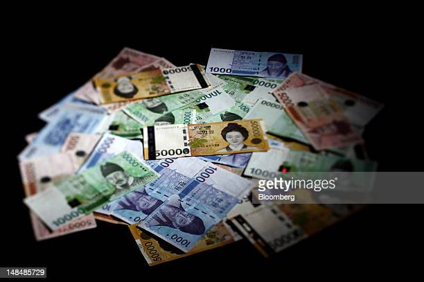South Korean won banknotes are arranged in this photograph taken with a tilt shift lens in Seoul South Korea on Tuesday July 17 2012 South Korea's...