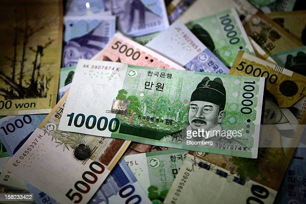 South Korean won banknotes of various denominations are arranged for a photograph in Seoul South Korea on Tuesday Dec 11 2012 South Korea's won pared...