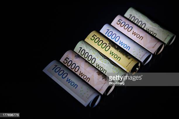 South Korean won banknotes of various denominations are arranged for a photograph in Seoul South Korea on Saturday Aug 24 2013 South Koreas won...