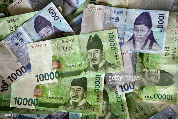 South Korean won bills are displayed for a photograph in Seoul South Korea on Sunday Sept 9 2007 Asian currencies dropped led by South Korea's won...