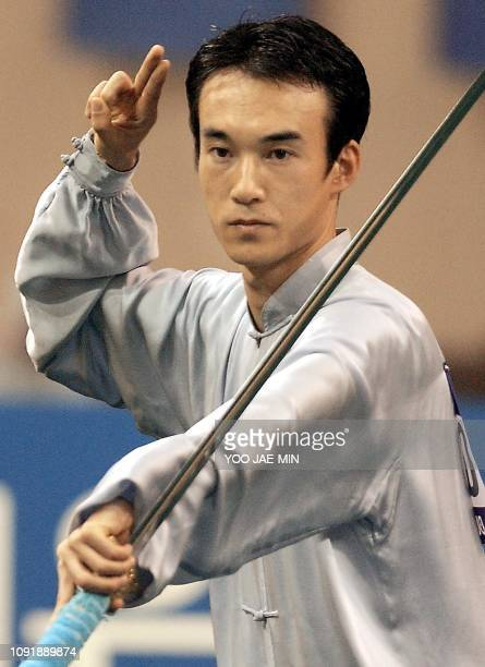 South Korean Yang Seong Chan performs during the men's taijiquan combined wushu event at the 14th Asian Games in Busan 12 October 2002 Yang won gold...