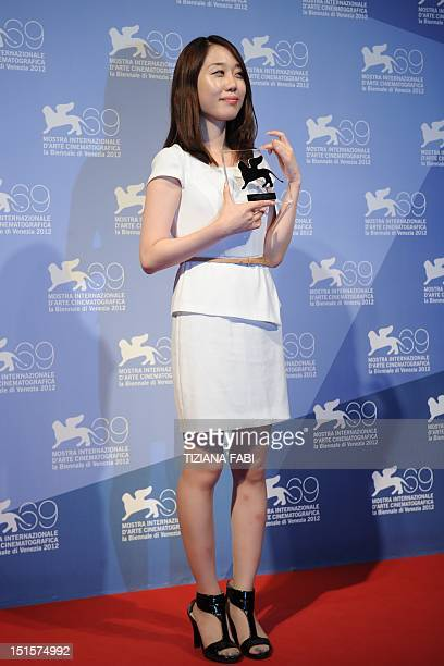 South Korean Yoo Minyoung poses with the Orizzonti Youtube award for Best Short Film she received for ChoDe during a photocall following the award...