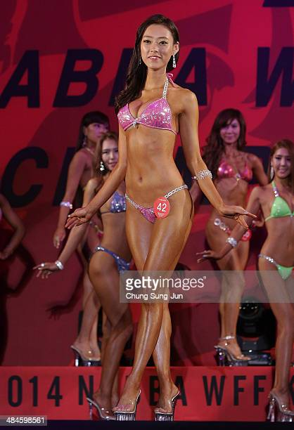 South Korean Yoon YoungHee performs in the WFF Miss Bikini competition during the 2014 NABBA/WFF Korea Championship on April 13 2014 in Daegu South...