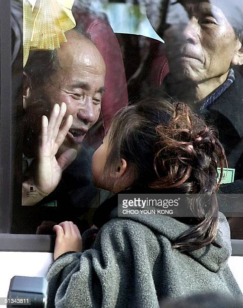 South Korean young girl kisses her grandfather who visits Seoul from North Korea to meet his long separated family since the Korean War through the...