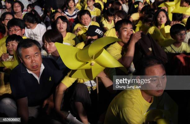 South Koreans attend the during a rally for victims of Sewol ferry on July 24 2014 in Seoul South Korea As many as 180 family members of the Sewol...
