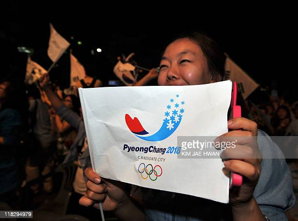 South Koreans celebrate after obtaining a firstround majority in the vote for Pyeongchang to host the 2018 Winter Olympics during a night rally to...