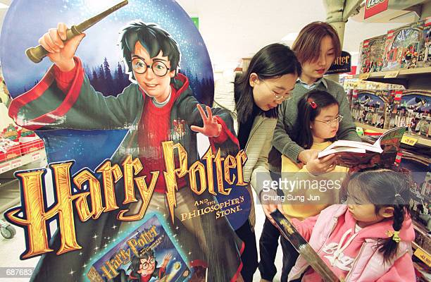 South Koreans child look at various items of merchandise featuring the characters from the film 'Harry Potter and the Sorcerers Stone' December 14...