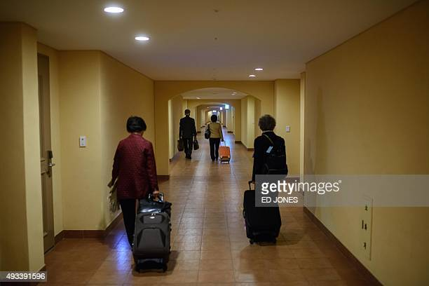 South Koreans chosen to attend a family reunion event with their North Korean relatives leave their hotel prior to departing for the border and...