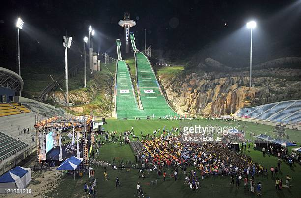 South Koreans gather at the ski jump stadium for night rally to support Pyeongchang's bid for the 2018 Winter Olympics in South Korea's mountain...