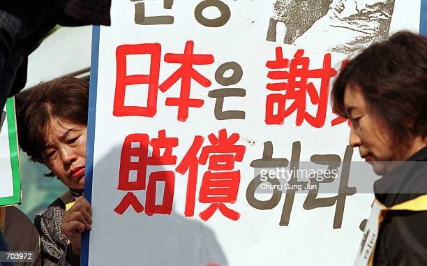 South Koreans hold placards with anti-Japanese sentiments during a rally to express anger over Japans 1910-45 colonial rule of the Korean peninsula,...