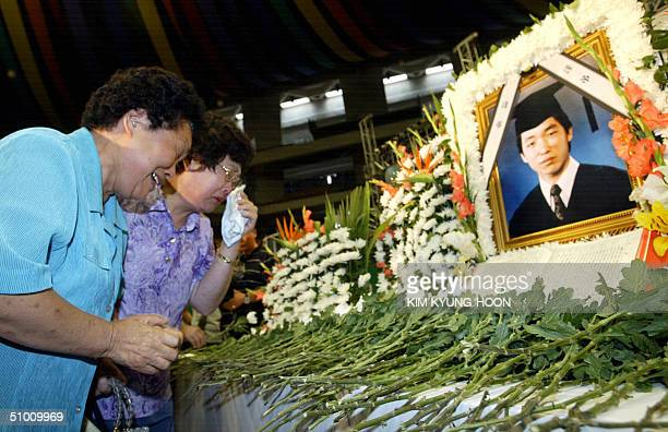 South Koreans mourn Kim Sunil who was killed by militants in Iraq at the funeral ceremony in Pusan about 420 km southeast of Seoul 30 June 2004...