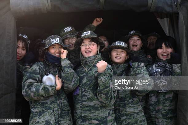 South Koreans participate in a marine's winter training camp course at a Pohang seashore military base on January 14, 2020 in Pohang, South Korea....
