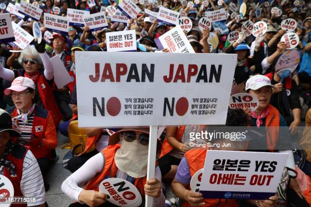 South Koreans participate in a rally to denounce Japan's new trade restrictions on South Korea on August 13 2019 in Seoul South Korea The bilateral...