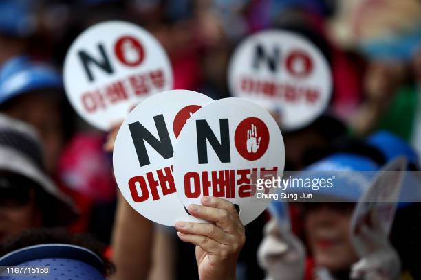 South Koreans participate in a rally to denounce Japan's new trade restrictions on South Korea on August 13, 2019 in Seoul, South Korea. The...