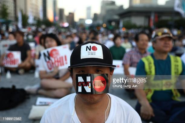 South Koreans participate in a rally to denounce Japan's new trade restrictions and Japanese Prime Minister Shinzo Abe on August 24, 2019 in Seoul,...