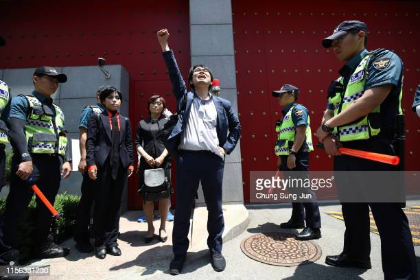 South Koreans participate in a rally to support Hong Kong's protest over extradition law in front of Chinese embassy on June 17 2019 in Seoul South...