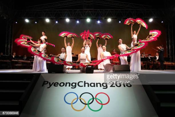 South Koreans perform on stage during the PyeongChang 2018 Winter Olympic Games torch relay on November 4 2017 in Busan South Korea