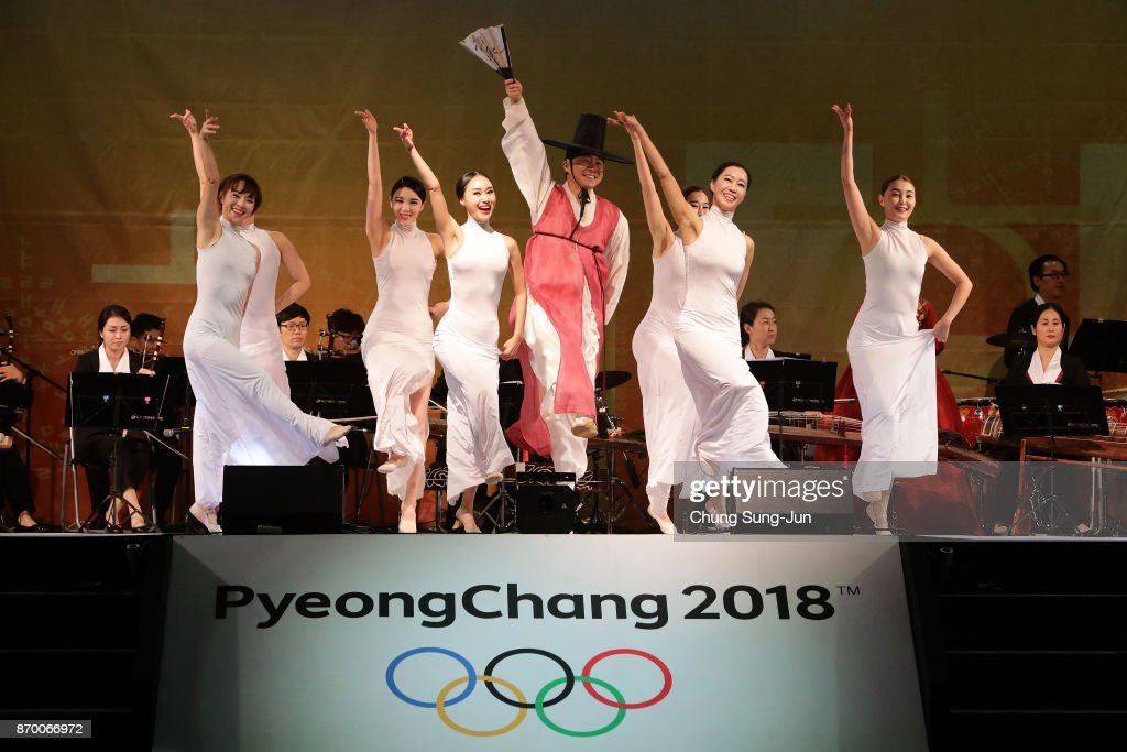 South Koreans perform on stage during the PyeongChang 2018 Winter Olympic Games torch relay on November 4, 2017 in Busan, South Korea.
