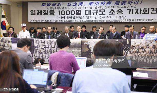 South Koreans representing a group seeking compensation from the South Korean government for wartime labor in Japan meet the press in Seoul on Dec 20...