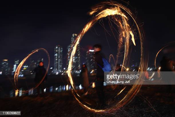 South Koreans spin fire cans during 'Jwibulnoli' a South Korean folk game on February 17 2019 in Seoul South Korea The event is part of a 'Daeboreum'...