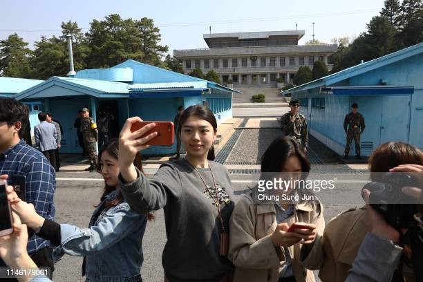 South Koreans take selfies as they tour the truce village of Panmunjom inside the demilitarized zone separating the South and North Korea on May 01,...