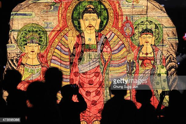 South Koreans walk beside colorful lanterns as they celebrate the forthcoming birthday of buddha on May 16, 2015 in Seoul, South Korea. As the exact...