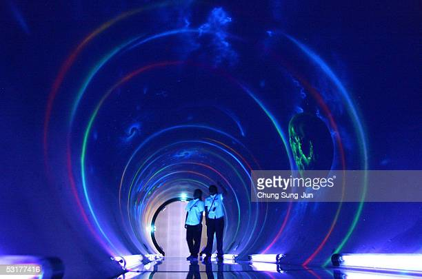 South Koreans walk through a 'Tunnel of Time' that visualises the passage of time at an exhibition commemorating the 100th anniversary of the...